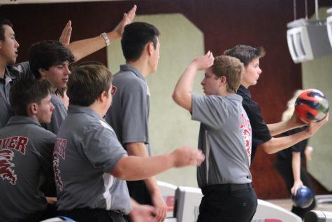 Varsity and Junior Varsity Cheer Teams Bring Home Championships
