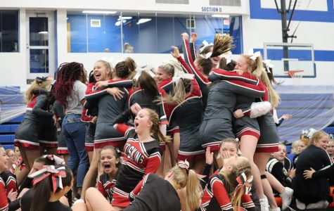Varsity and Junior Varsity Cheer Teams Bring Home Championships